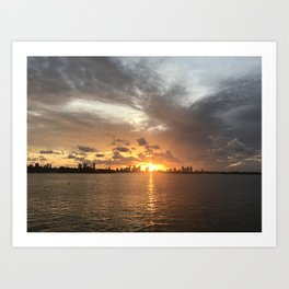 Sunset in Miami with cloudy sky and calm sea Art Print