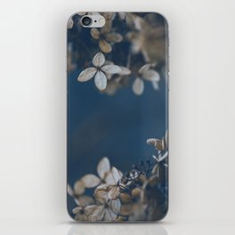 White Floral Pattern Against Blue Background iPhone Skin