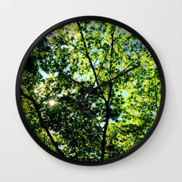 green leaves and sun - look at the sky Wall Clock