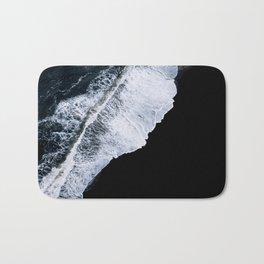 Waves crashing on a black sand beach – minimalist Landscape Photography Bath Mat