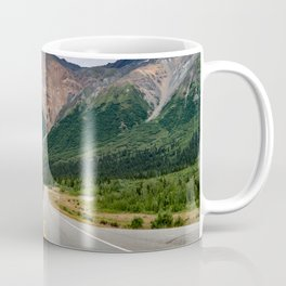 View of the Richardson Highway near Delta Junction Alaska. Empty road in the middle of the highway. Coffee Mug