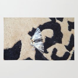 Butterfly machaon sitting on the carpet Rug