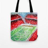ohio state Tote Bags featuring Ohio State Buckeyes by Emily Kenney