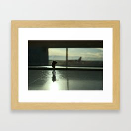 Alone in the airport. Framed Art Print