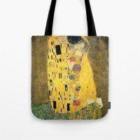 gustav klimt Tote Bags featuring The Kiss - Gustav Klimt by BravuraMedia
