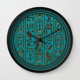 Egyptian Golden Leather hieroglyphs embossed on teal Wall Clock