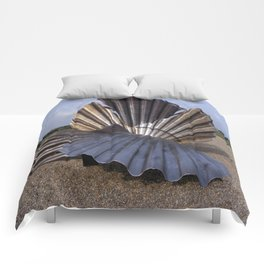 The Scallop sculpture by Maggi Hambling.  Comforters