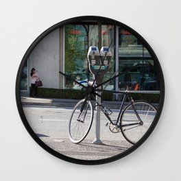 Bike locked to parking meter Wall Clock