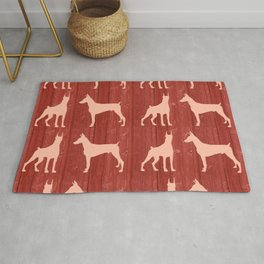 Red wooden board with dobermans shapes Rug