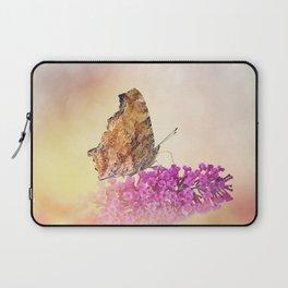 Butterfly feeds on flowers in the garden Laptop Sleeve