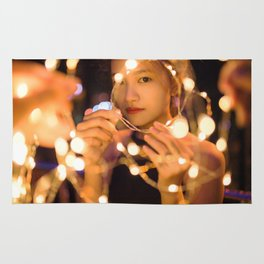 Woman Through String of Lights Rug