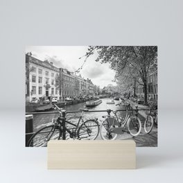 Bicycles parked on bridge over Amsterdam canal Mini Art Print