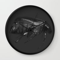 beetle Wall Clocks featuring Beetle by Lauren Rakes