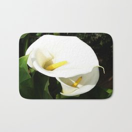 Beautiful White Calla Flowers In Bright Sunlight Bath Mat