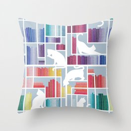 Rainbow bookshelf // pastel blue background white shelf and library cats Throw Pillow