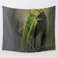 volkswagen Wall Tapestries featuring Green Grasshopper sitting on an old Volkswagen microbus by Premium
