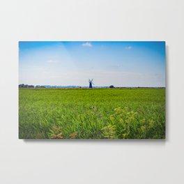 Green Grass Field with Windmill on Horizon Metal Print