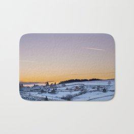 Winter Sunset over small vilage Bath Mat