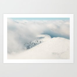Clouds clearing above spruce forest and snowy mountains Art Print