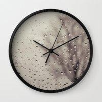 rain Wall Clocks featuring Rain  by Laura Ruth