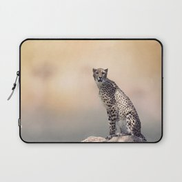 Young Cheetah sitting on a rock Laptop Sleeve