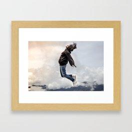 Girl on clouds Framed Art Print