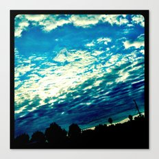 Over the shoulder clouds. Canvas Print