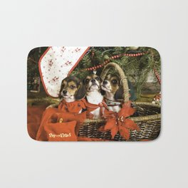 Three Tricolor Beagle Puppies in a Basket underneath a Christmas Tree Bath Mat