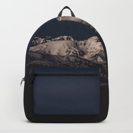 Dreamy sunset on the mountain top Backpack