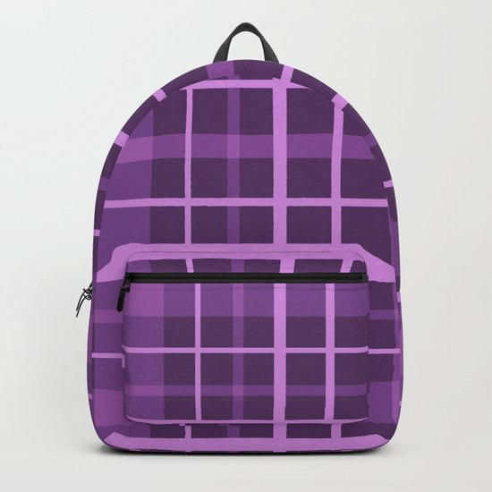 Plaid in black and purple colours . Backpack