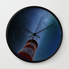 Lighthouse under starry sky Wall Clock