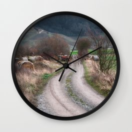 Long dirt road leading to the hill Wall Clock