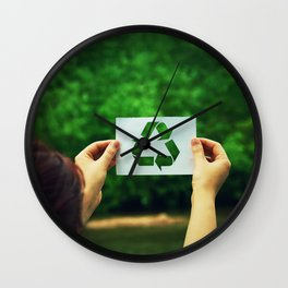 holding recycle symbol Wall Clock
