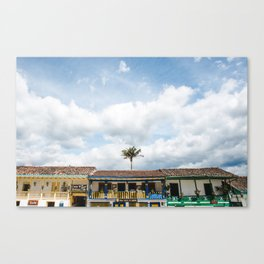 Palm tree sticks out above typical Colombian colourful houses in Salento, Colombia's coffee region zona cafetera | South America travel destinations Canvas Print