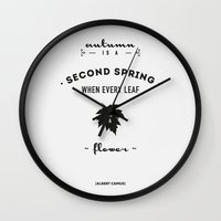 camus Wall Clocks featuring  Albert Camus Quote - Autumn is a second spring when every leaf, is a flower. by Spyros Athanassopoulos