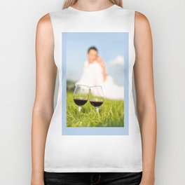 Two wineglasses with red wine in grass Biker Tank