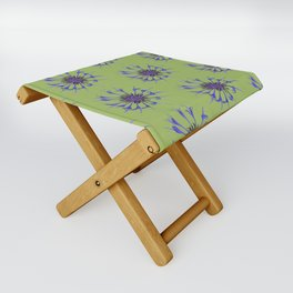 Thin blue flames in a sea of green Folding Stool