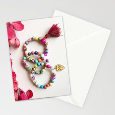 Red tassel charm beaded bracelets by Quest Stones Stationery Cards