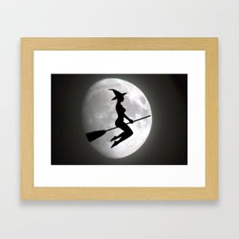 Witch On a Broom Against the Moon Framed Art Print