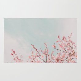 Pink Flowers in the Sky Rug