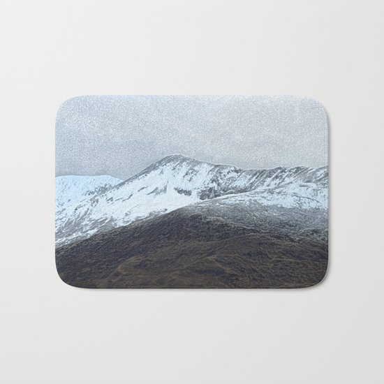 Off in the crouching mountains Bath Mat
