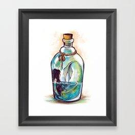 A bottle of mermaid Framed Art Print
