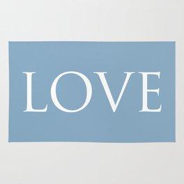 Love word on placid blue background Rug
