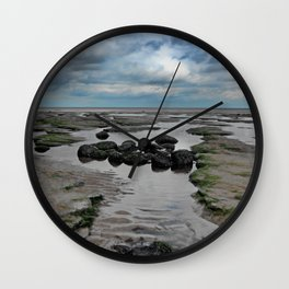 The Water Slips Away Wall Clock