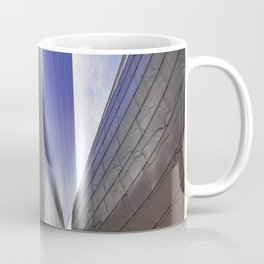 Architectural abstract of a metal clad building looming in symmetry. Coffee Mug