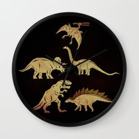 dinosaurs Wall Clocks featuring Dinosaurs by chobopop