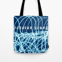 forever young Tote Bags featuring forever young by Bunny Noir