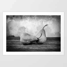 Two large yellow bosc pears on a barn wood table black & white Art Print