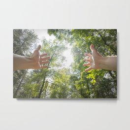 Arms raised in a forest Metal Print