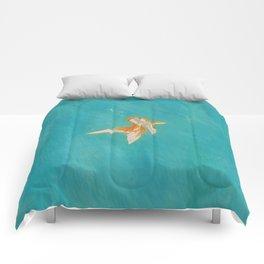 Goldfish in the ocean Comforters